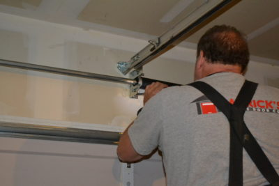Patrick making repairs on a garage door in Vancouver, WA